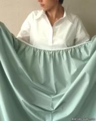 Woman holding Sheet - Step 1