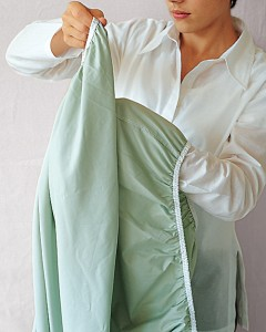 Woman folding Sheet - step 2
